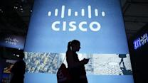 Cisco reports earnings, revenue beat