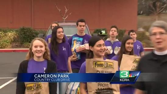 Church youth group collects food on Super Bowl Sunday