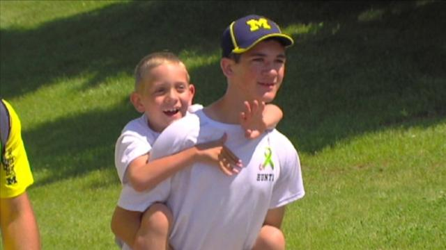 Teen Finishes 40-Mile Trek Carrying Brother on His Back