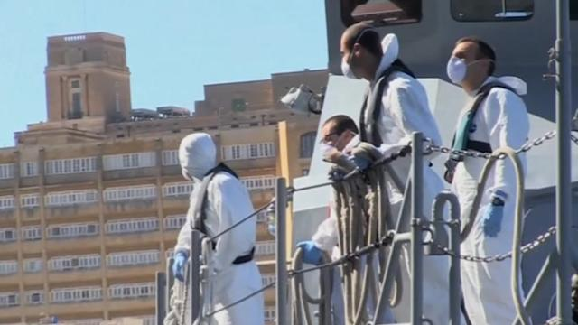Migrants rescued by a U.S. Navy ship arrive in Malta