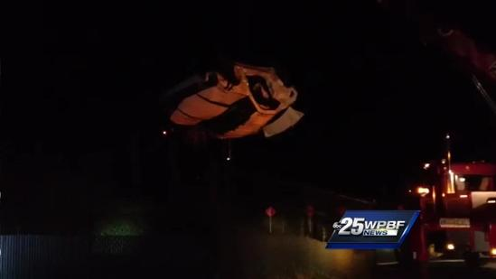 Raw video: Tow truck pulls car from drainage ditch after crash