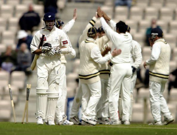 Michael Vaughan of Yorkshire walks back to the pavilion after being bowled by Wasim Akram of Hampshire