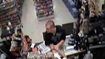 Raw Video: 71-year-old store clerk robbed