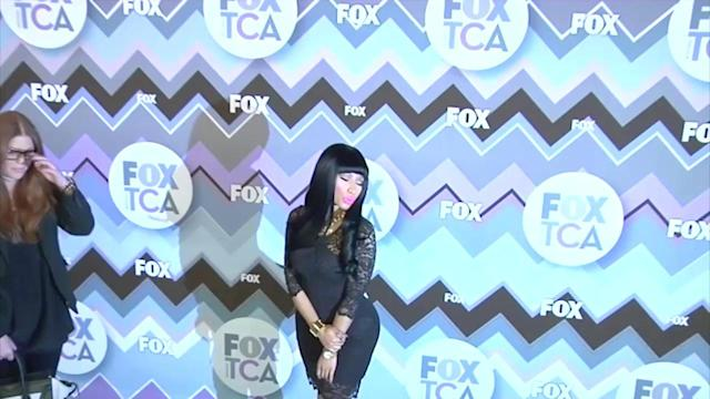 Nicki Minaj Shows Off Her Derriere in a Tight Lace Dress