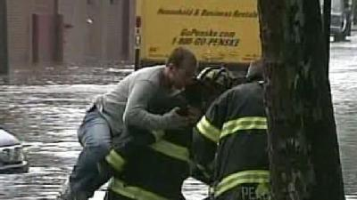 Firefighters Rescue Flood Victims