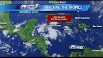 Rain likely Wednesday; tropical system given 40 percent chance of developing