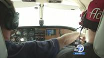 Pediatric patients fly planes above Long Beach