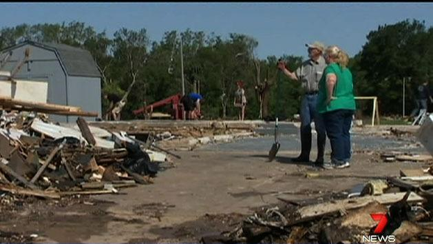 Tornado cleanup hampered by flooding