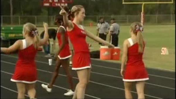 Judge rules for cheerleaders in Bible banner suit