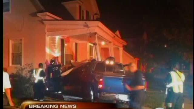 Pickup truck crashes into house