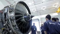 Rolls-Royce halves dividend, but shares rise
