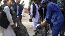 Officials: Afghan bomber kills at least 36