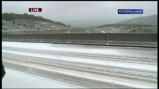 Slick roads and bridges in Winslow from May snow