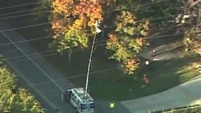 Local Television Station News Truck Collides With Power Lines