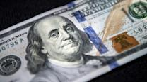 $100 bill revamped to ward off counterfeiters