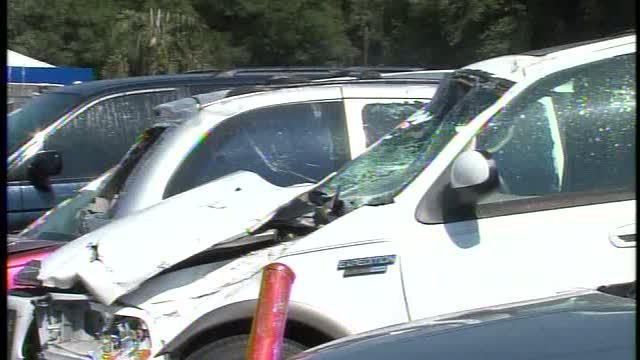 Deputies: Violent fight leads to crash at car lot