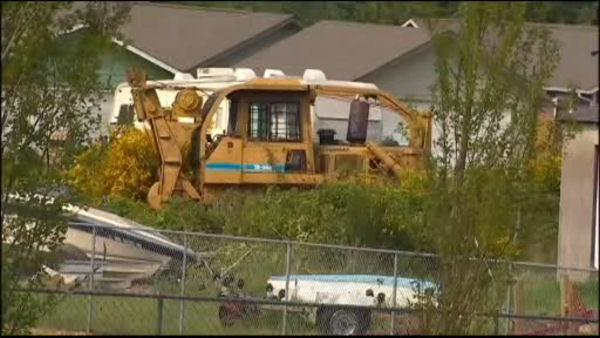 Washington man attacks neighbors' homes with bulldozer
