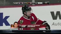 Patrick Sharp beats Giguere up high