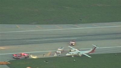 Plane Slides Off Runway At Louisville Int'l Airport