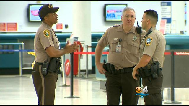 Passenger Detained After Device With Words