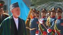 Karzai calls on Taliban to put down arms