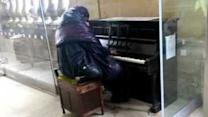 Homeless Musician Stuns Passers-by With Piano Performance