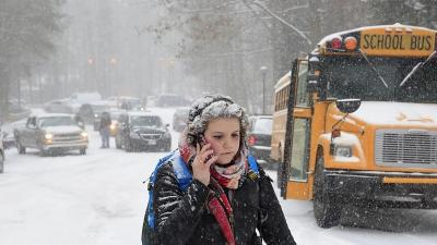 Winter Storm Snarls Travel, Causes Outages