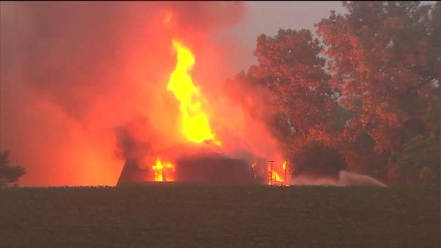 House engulfed in flames after lightning strikes
