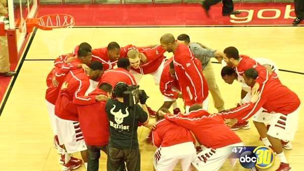 'Dogs Men Lose, Women beat New Mexico