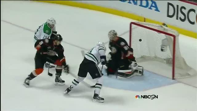 Horcoff cleans up a loose puck in tight