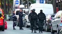 Paris bank hostage-taker surrenders, leaves building