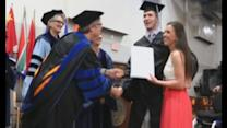 Paralysed student walks to collect diploma at graduation