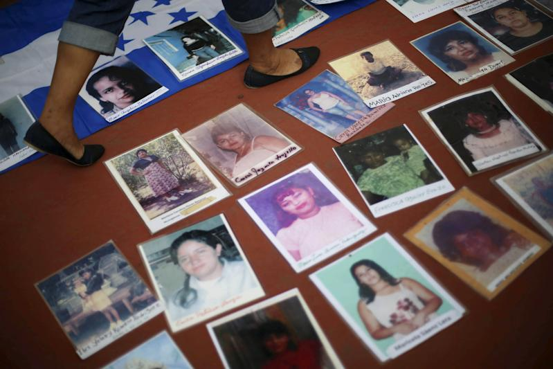 "Photos of missing migrants are seen during a visit of the ""Caravana de Madres Centroamericanas"" (Caravan of Central American Mothers) to La Merced neighborhood during a journey searching their relatives in Mexico City, December 9, 2015. The group, made up of relatives of people from Nicaragua, Honduras, El Salvador and Guatemala who went missing while making their way to the U.S., marched to demand that the governments of Central America stop kidnappings and other crimes committed by organised criminal groups on migrants, according to local media. REUTERS/Edgard Garrido"