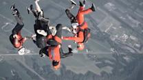 Skydivers Fearlessly Fly Over Chicago