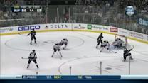 Anze Kopitar chips it past Enroth
