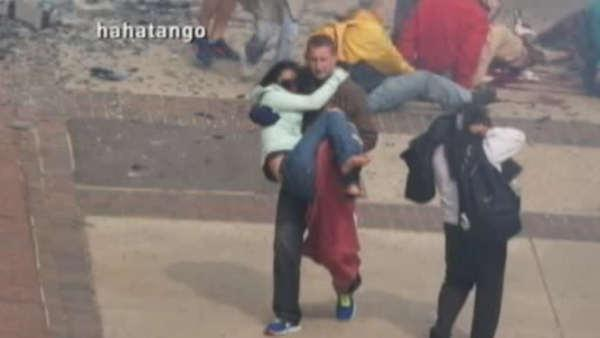 Man carries friend moments after bombing