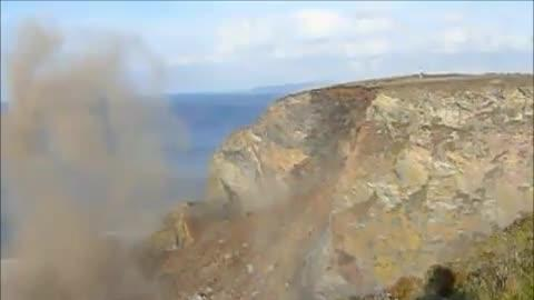 Mountainside Cliff Crashes Into Water