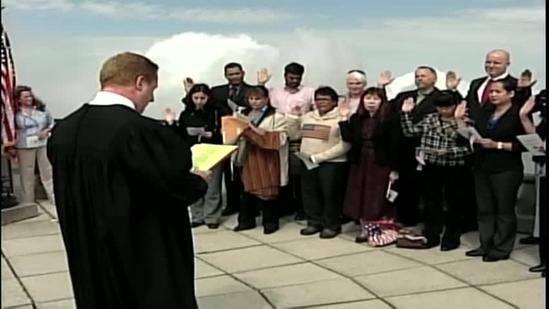 Citizens sworn in on top of mountain