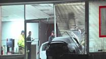 4:30am: Car crashes through dealership