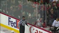Ref throws first-goal puck in the stands