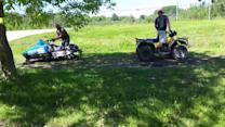 Quad and Snowmobile Play Tug of War