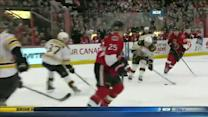 Brad Marchand dekes Senators defense to score