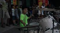 Seven-year-old drummer's impressive street performance
