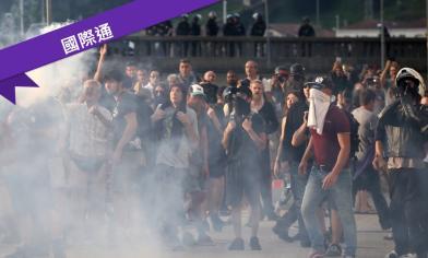 萬人抗議G7 遭水柱催淚彈驅離