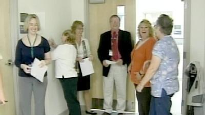 Hospital Staff Line Up For Shots