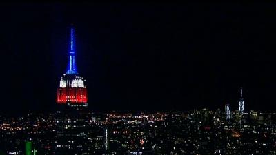 Raw: Empire State Lit Up Red, White and Blue