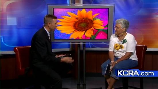 Nancy Siegler shows the power of the sunflowers