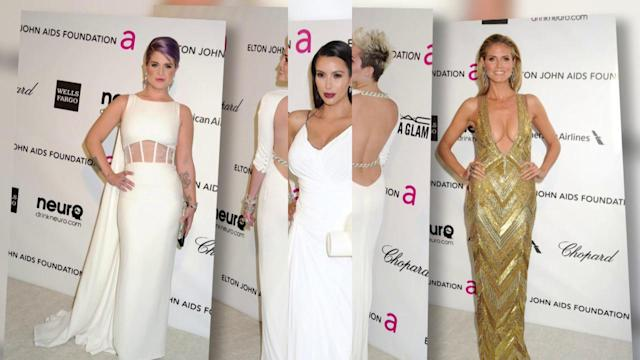 Kim Kardashian Shows Off Baby Bump in a Plunging White Gown at Oscar Party