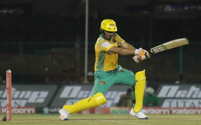 Bharath Chipli drives through the covers during a KPL match