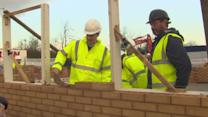 Osborne laying bricks at Housing Association